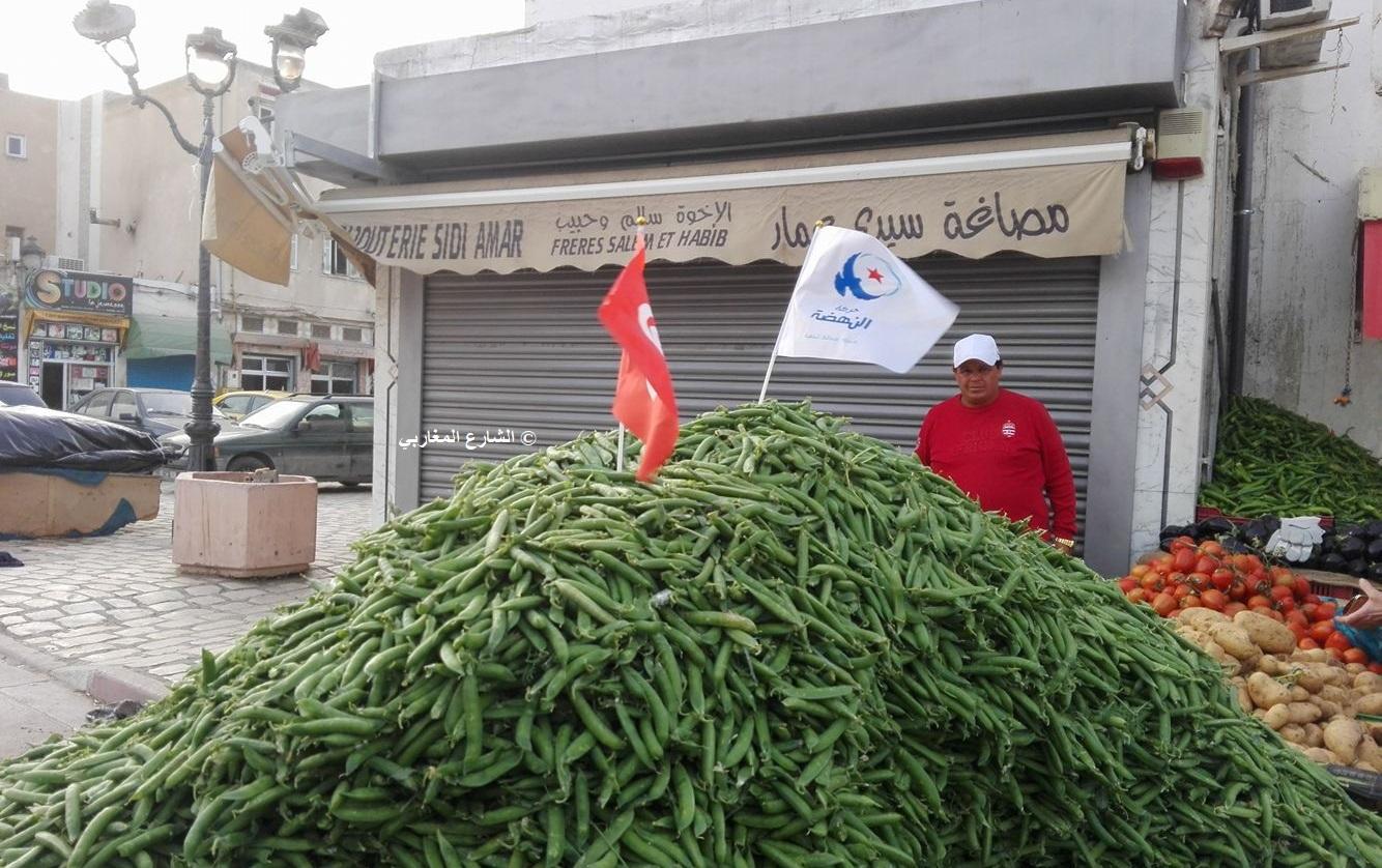 """صورة بألف كلمة : """"الجلبانة"""" تُصوّت لحمامة النهضة في سوق أريانة!!!"""