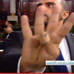 صور: راشد الخياري يقف أمام الكاميرا لحجب عبير موسي ويرفع شعار رابعة